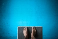 feet at the edge of a diving board